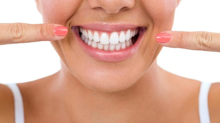 family dentist elk grove village il | woman smiling